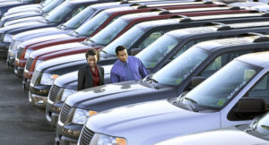 couple on a car lot buying a car