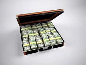 Suitcase filled with money representing how to make a million dollars